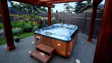 A hot tub surrounded by a garden