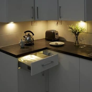 recessed lights over a kitchen counter