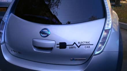 A silver Nissan electric car